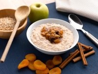 Rolled oat porridge with milk, topped with fruit compote of sultanas, apricots, apple and sugar cinnamon.