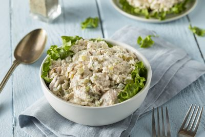 Homemade Healthy Chicken Salad in a Bowl. Bowl of lettuce greens topped with creamy chicken salad
