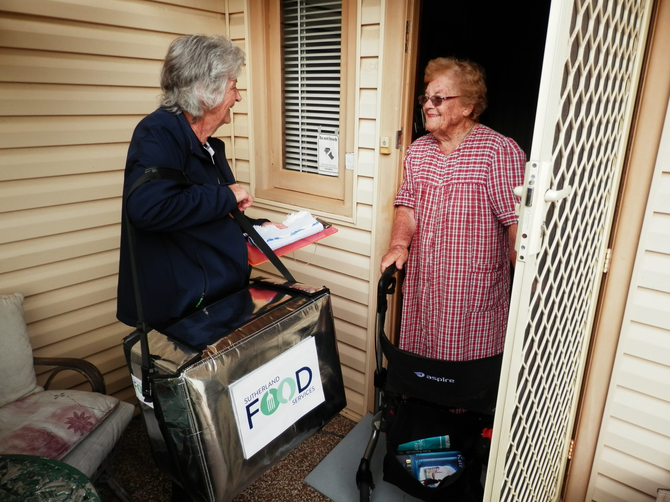 Volunteer delivering to customers door